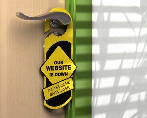 Black and yellow door hanger on doorknob that reads Our Website is Down